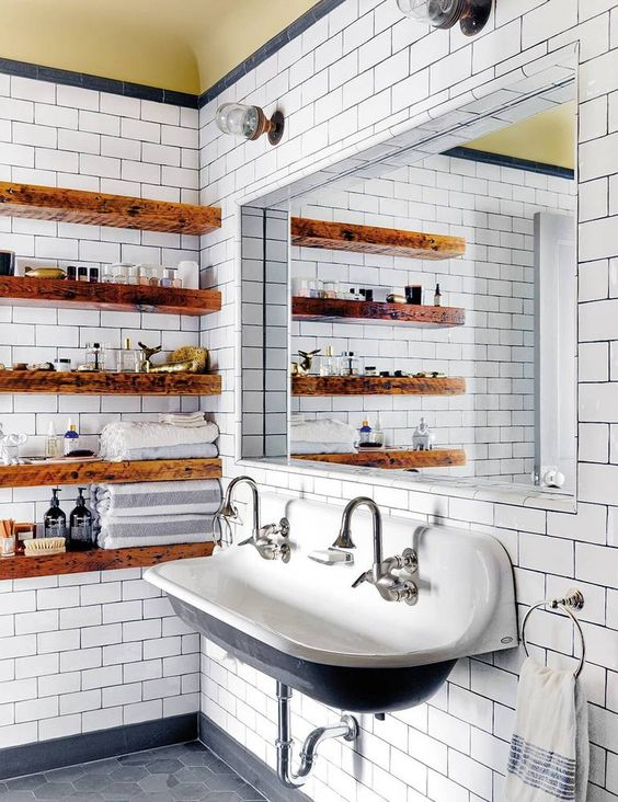 staiend wooden slab open shelves soften the vintage industrial bathroom making it look warmer