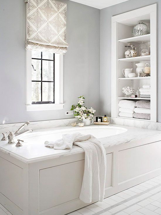 built-in shelves over the bathtub are a nice solution for storing a lot of things without wasting floor space