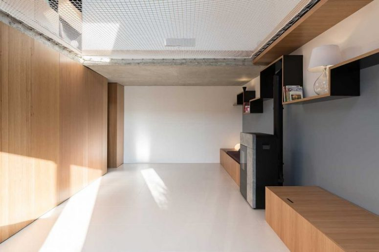 This space is rather minimal, with another daybed with storage and a hearth plus net over it