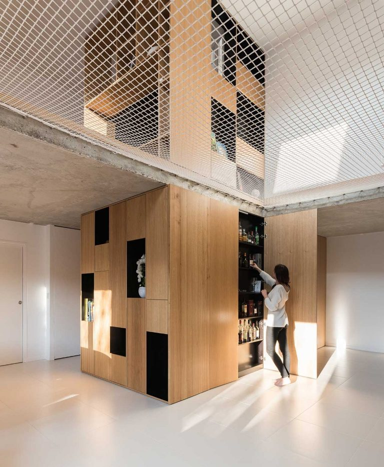 There's a bathroom inside the cube and you may see a home bar built-in here