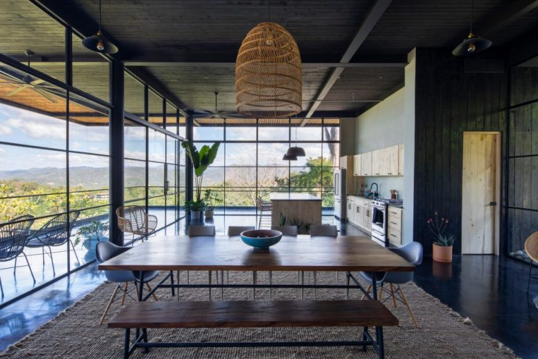 The kitchen and dining space are on the ground floor and can be opened to a large terrace, if not, they still get much natural light through glass walls