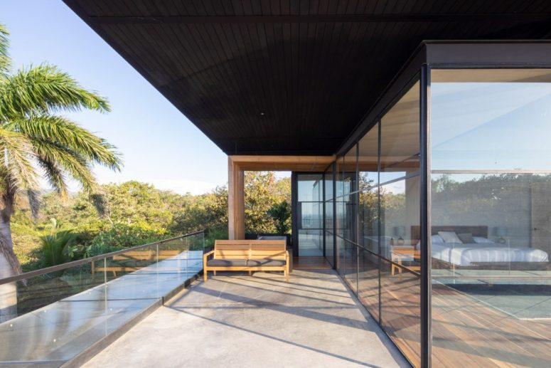 The upstairs section of the house contains the private bedrooms which are encased in glass and enjoy beautiful views