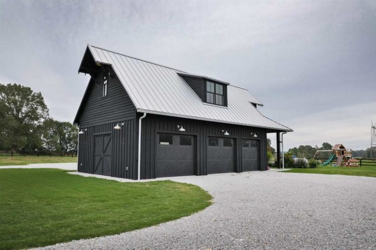 The barn is a three-car garage that was designed so not to spoil the look of the property