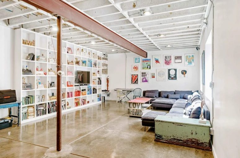 This is a reading and TV watching salon with much art and chic furniture