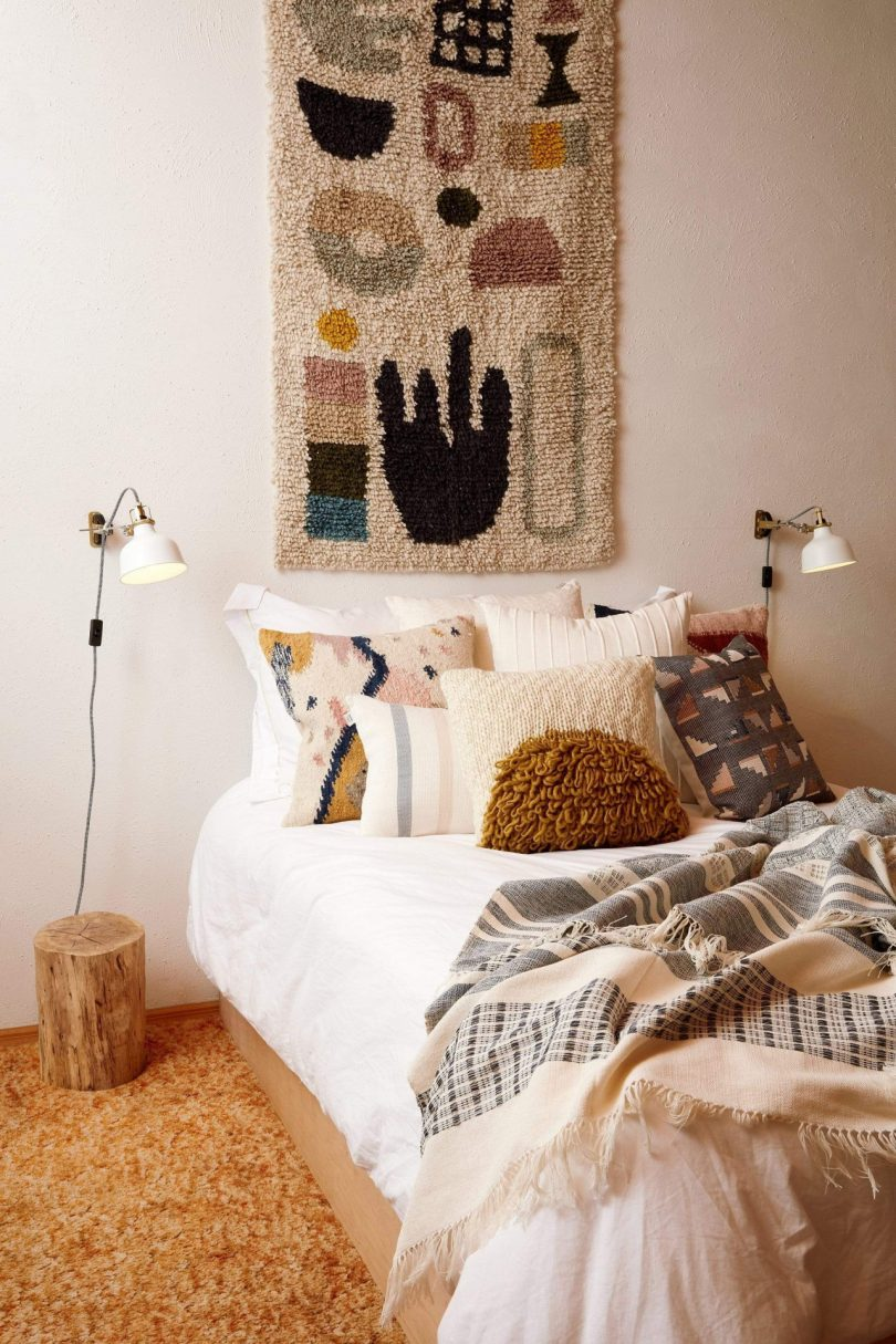 A rug hanging on a wall as decor