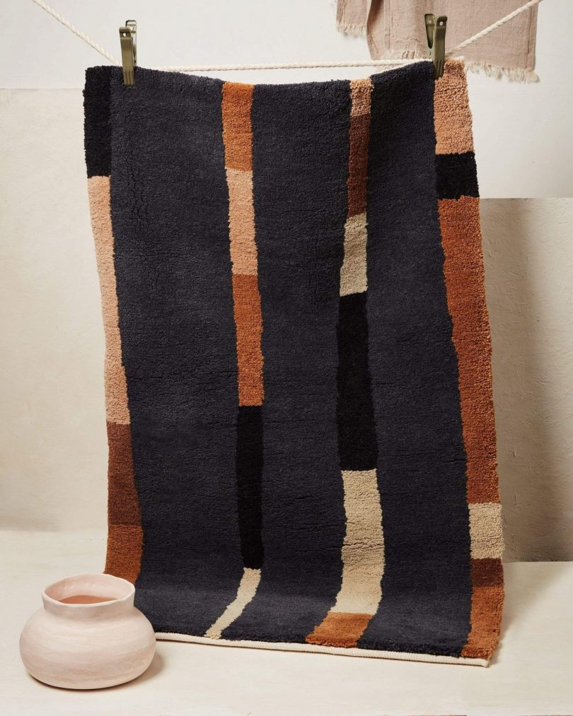 MINNA Goods rug hanging on wall