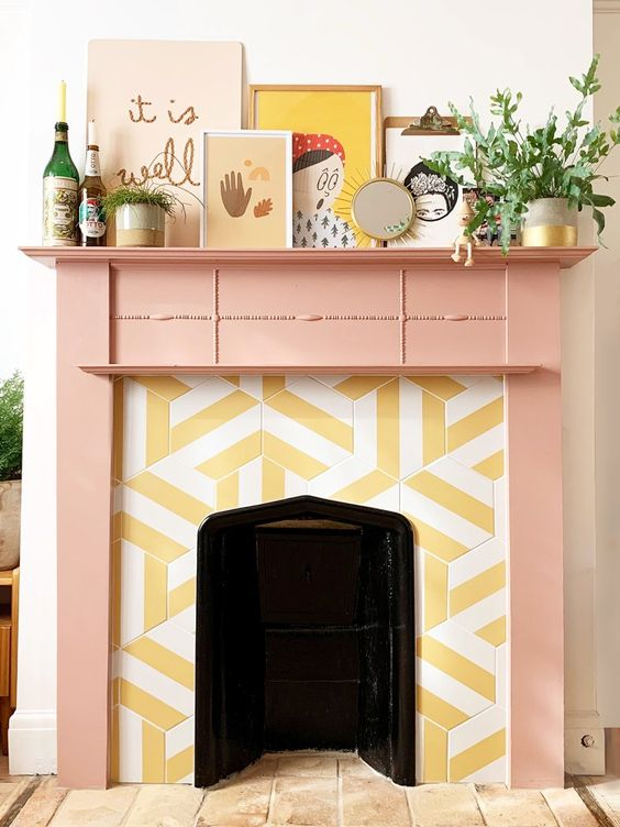 a cheerful fireplace with hex striped tiles around and a pink mantel plus quirky art looks very unusual and whimsical