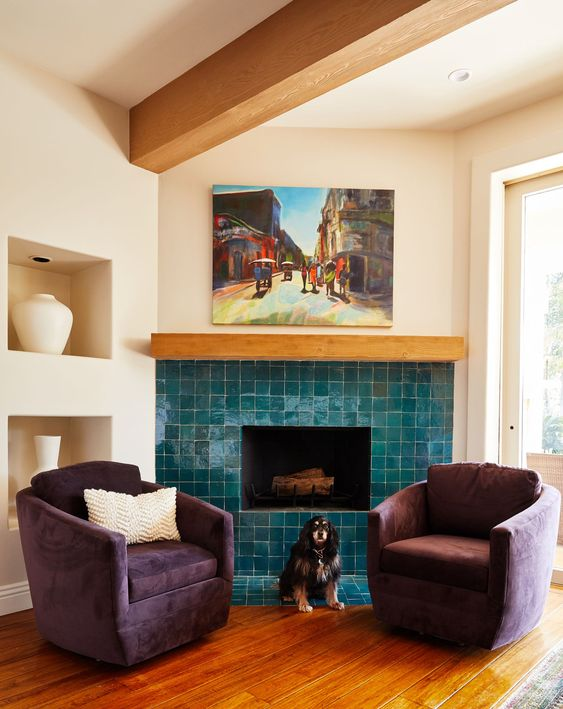 a chic and cozy nook with a fireplace clad with glossy blue tiles and purple chairs is a bold space decorated with impeccable taste