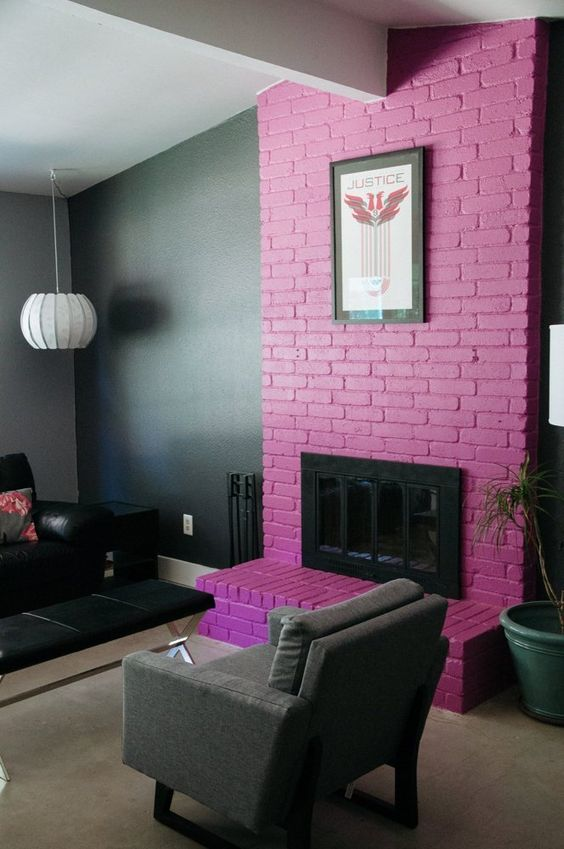 a moody living room with a hot pink brick fireplace that brings much color and makes the space playful