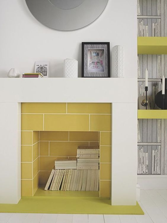 mustard tiles inside the fireplace and a neutral surround create a bold contrast that strikes and makes the space catchier