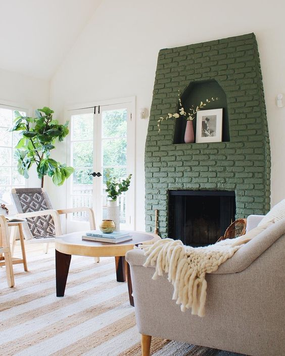 a fireplace with a green brick surround brings color to this neutral space and makes it catchier and more interesting