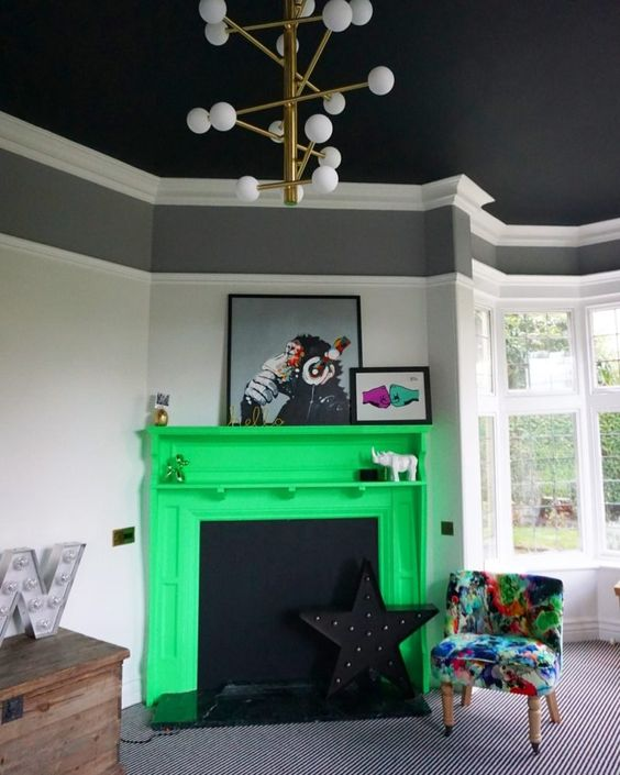 a moody living room spruced up with a neon yellow faux fireplace and a colorful printed chair