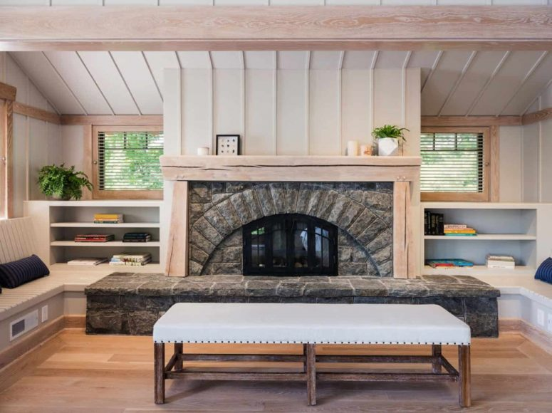 This is a very cozy space for reading and conversations, with a stone clad fireplace