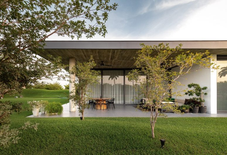 The landscaping is done sleek and elegant, there are some outdoor spaces including this patio