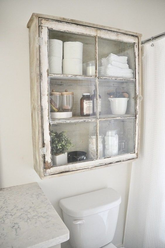 a shabby chic cabinet with an old window frame as a door is a cool idea to repurpose some things and get a new furniture piece