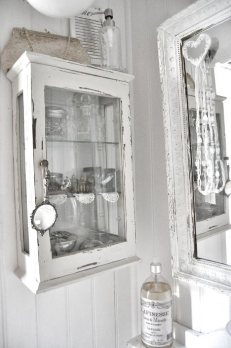 a vintage glass cabinet made of old window frames will be a beautiful solution for a kitchen or a bathroom