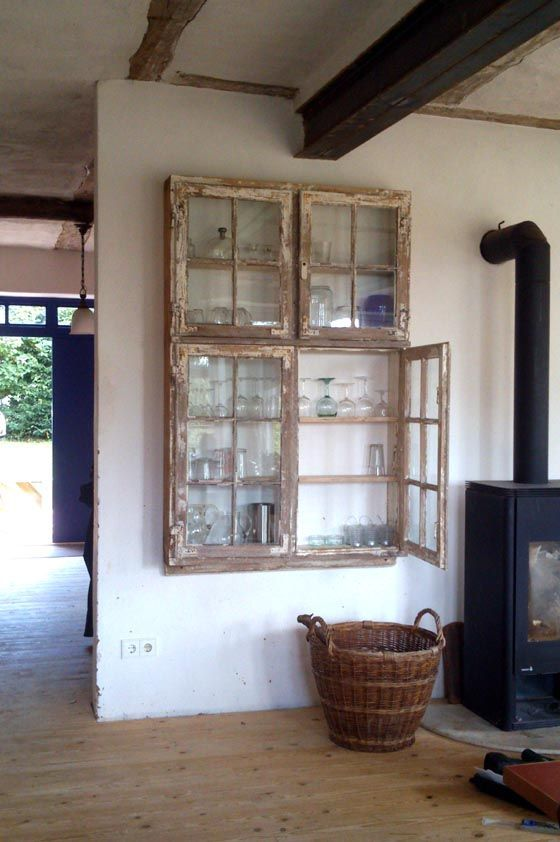 a shabby chic cabinet with old window frames as doors is a stylish idea for both indoors and outdoors and will fit a vintage space, too
