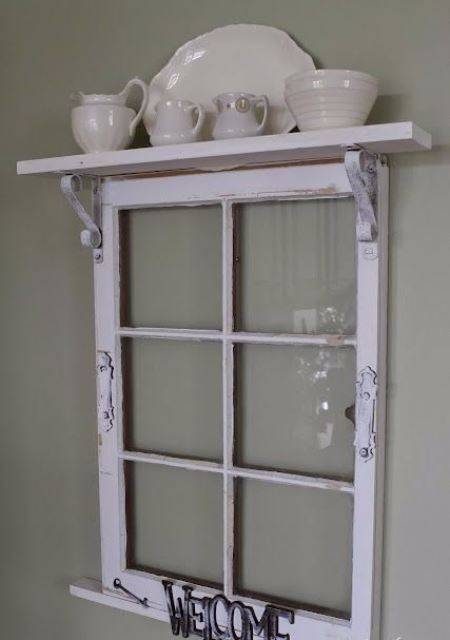 a vintage shelf of an old window frame, some letters and a plank on top, with elegant porcelain is a stylish idea