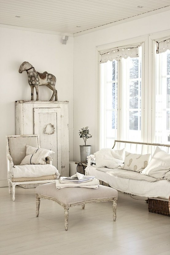 a beautiful neutral shabby chic living room with refined vintage furniture, a wardrobe and pretty and unusual decor