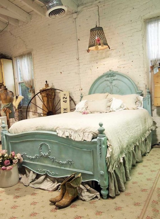 a vintage and shabby chic bedroom with white brick walls, a mint bed, vintage artworks and manequins plus pendant lamps
