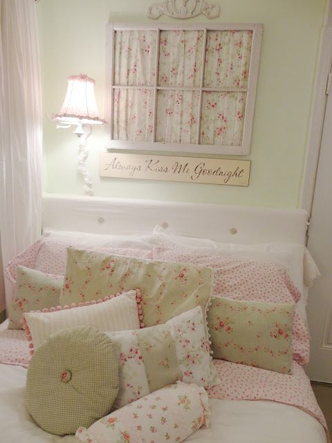a pastel and floral vintage bedroom with light green walls, a window frame with floral fabric and floral bedding on the bed