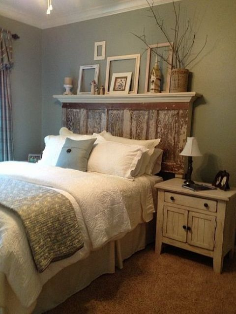 a vintage rustic bedroom with green walls, rustic furniture, green and white bedding, a shelf with frames for decor