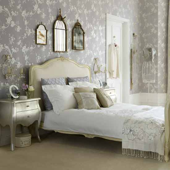a lavender, white and gold vintage bedroom with printed wallpaper, chic and elegant furniture, a gallery wall and shiny metals
