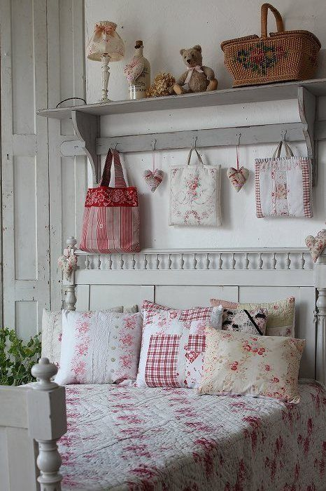 a vintage bedroom in neutrals, with neutral vintage furniture, printed textiles, greenery and toys plus Christmas bedding
