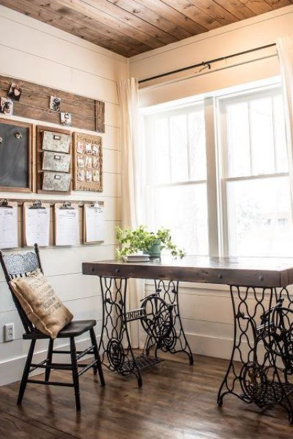 a vintage rustic home office with a chic desk, a wooden chair, a wooden board and a chalkboard is very cozy