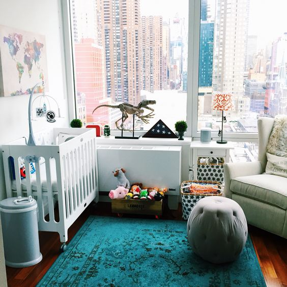 a gender neutral nursery with a view, bold printed and colorful textiles, rather neutral furniture, colorful toys is a cool idea