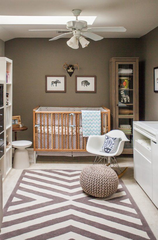 a gender-neutral nursery with taupe walls, white and neutral furniture, printed textiles and a skylight on the ceiling