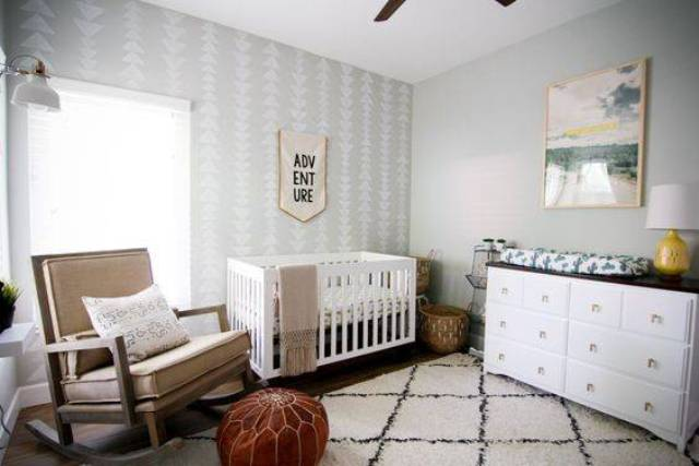a neutral mid-century modern nursery with elegant furniture, a leather ottoman, signs and artworks is a very cozy and welcoming space