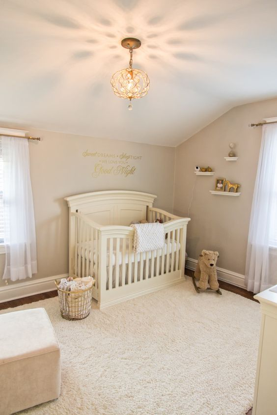 a neutral vintage nursery with elegant furniture, open shelves, printed bedding and neutral toys to match the space