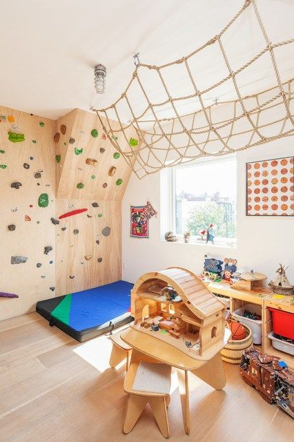 a fun and creative kids' playroom with a climbing wall, a net and many toys is a very bold idea to try