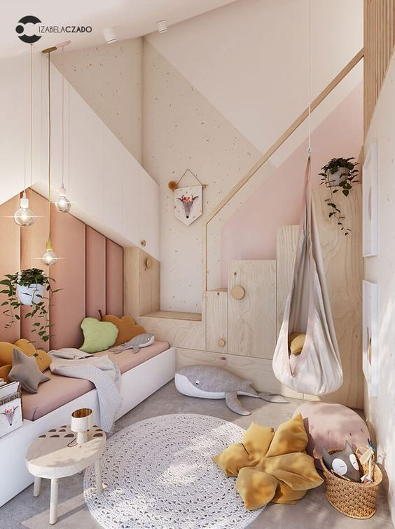 a contemporary pastel bedroom with an upholstered wall, creative storage units, layered rugs and pretty throws and toys
