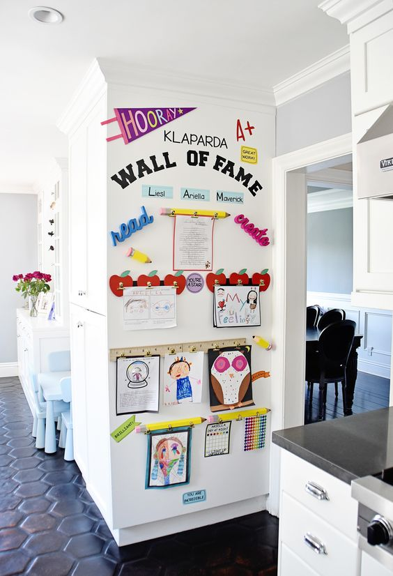 a wall of fame is a gorgeous way to make your kids feel proud of what they have created