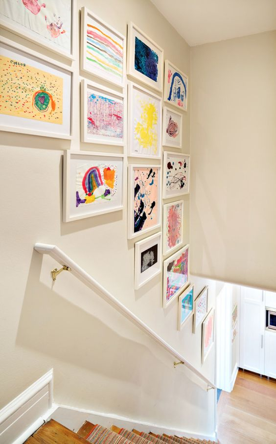 a stylish gallery wall over the staircase will display your kids' works at their best and they will be seen any time