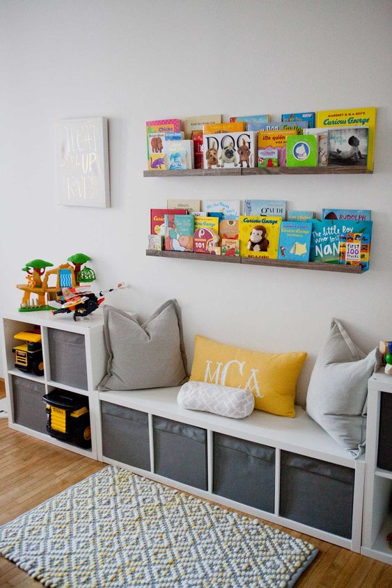 a stylish reading nook with a comfy bench and pillows and wooden ledges on the wall to display the books