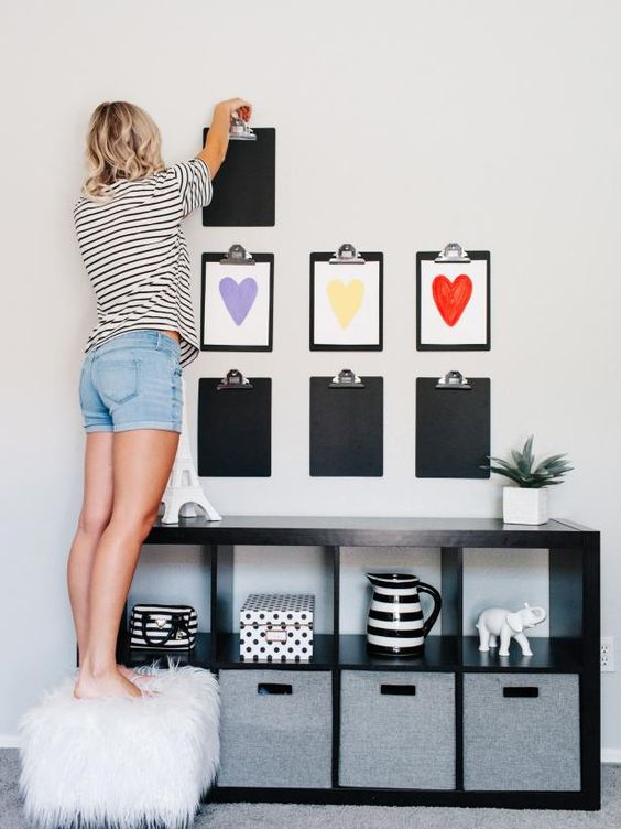 a kids' artwork gallery wall organized like that is a very creative and bold idea to go for