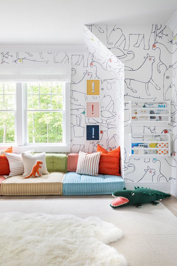a stylish modern reading nook with colorful seats and pillows, bold art and books in shelves