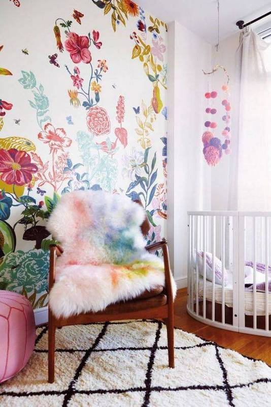add a girlish accent to this nursery with bold floral wallpaper and support it with bedding or furniture covers