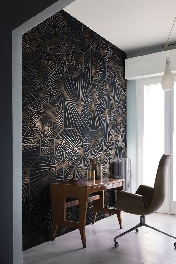 an exquisite modern home office nook with a bold geometric print statement wall, catchy furniture and candle lanterns