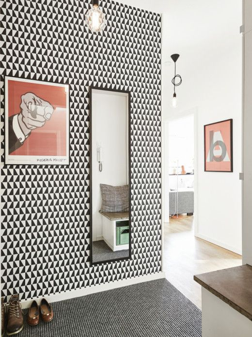 monochrome geometric wallpaper in the entryway for an eye-catching touch and a pattern touch in the space