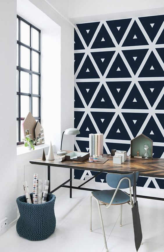 monochromatic geometric self-adhesive wallpaper is a great idea for a modern workspace, to make it bolder and statement-like