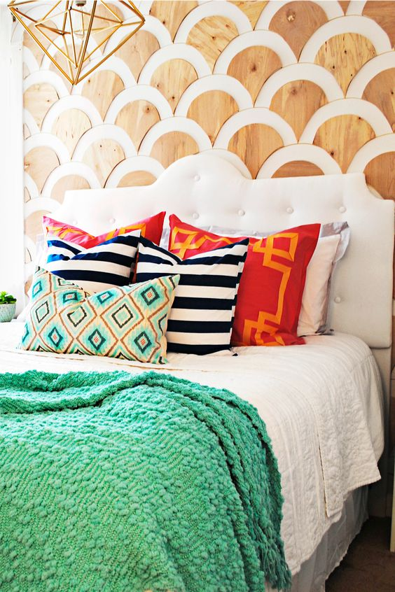 a creative statement wall done with plywood scallops is a very bold and unique idea for your bedroom