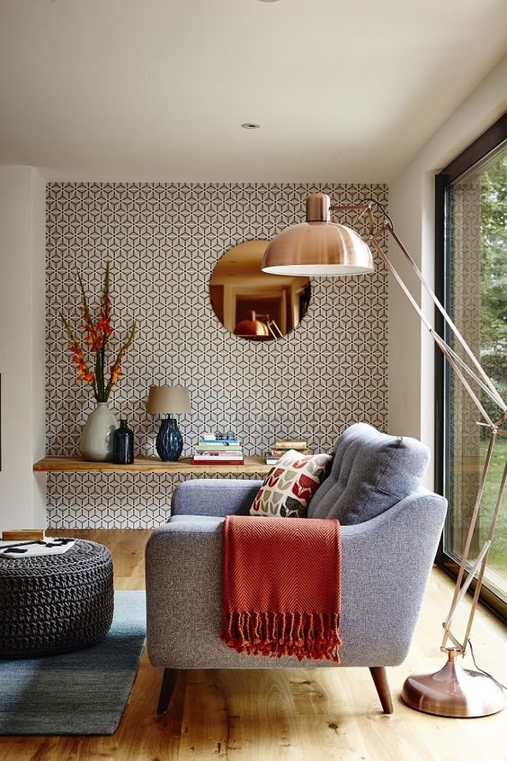 a reading nook highlighted with geometric wallpaper that highlights the mid-century modern decor of the room