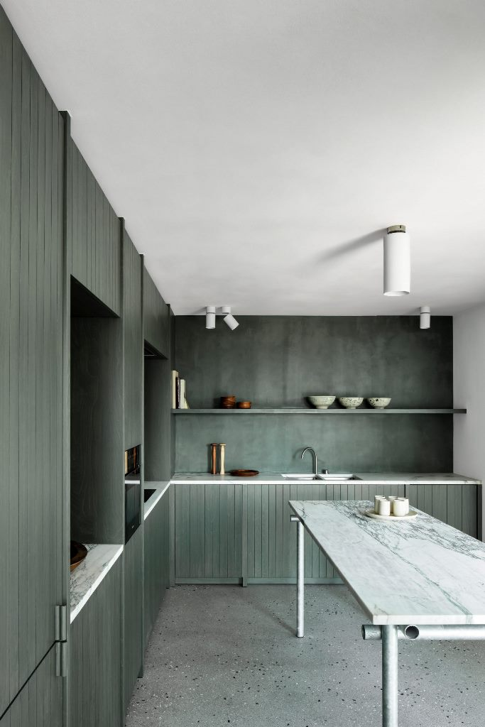 This apartment is inspired by the coast and its colors and features a color palette accordingly, seaweed and greens