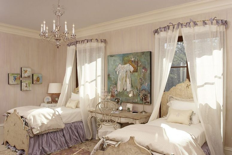 a refined shabby chic shared kids' bedroom with wallpaper walls, a lavender ceiling, elegant vintage furniture, canopies and a pretty chandelier