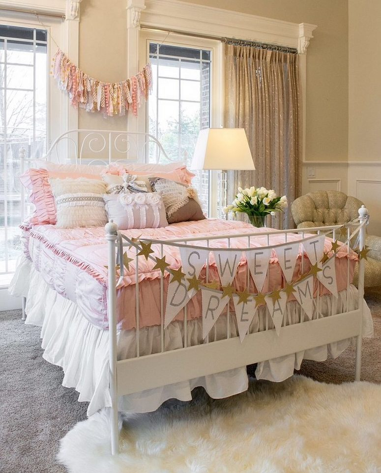 a shabby chic kid's bedroom with tan walls, vintage furniture, pink and white bedding, garlands and bannets and sparkling curtains