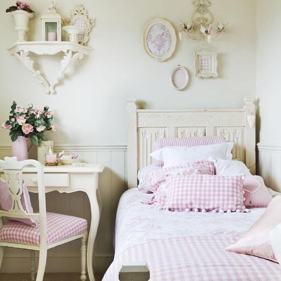 a pretty shabby chic kid's room with pastel walls and furniture, with pink plaid bedding and upholstery is very girlish and cute